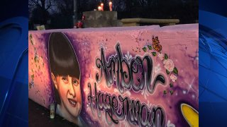 Mourners spent Monday evening at a special mural in Arlington that honors the Arlington girl whose abduction and murder led to the worldwide Amber Alert notification system to find missing children.