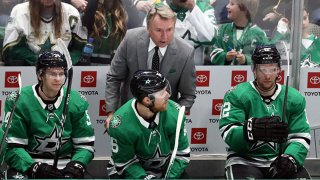 Interim coach Rick Bowness of the Dallas Stars talks with Joe Pavelski #16 during play against the New Jersey Devils in the third period at American Airlines Center on Dec. 10, 2019 in Dallas, Texas.