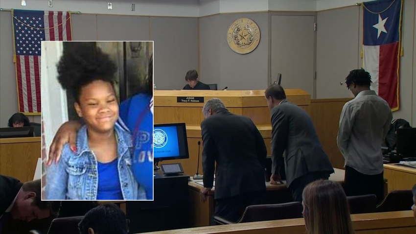 a photo of the trial where one man is facing a charge of organized criminal activity