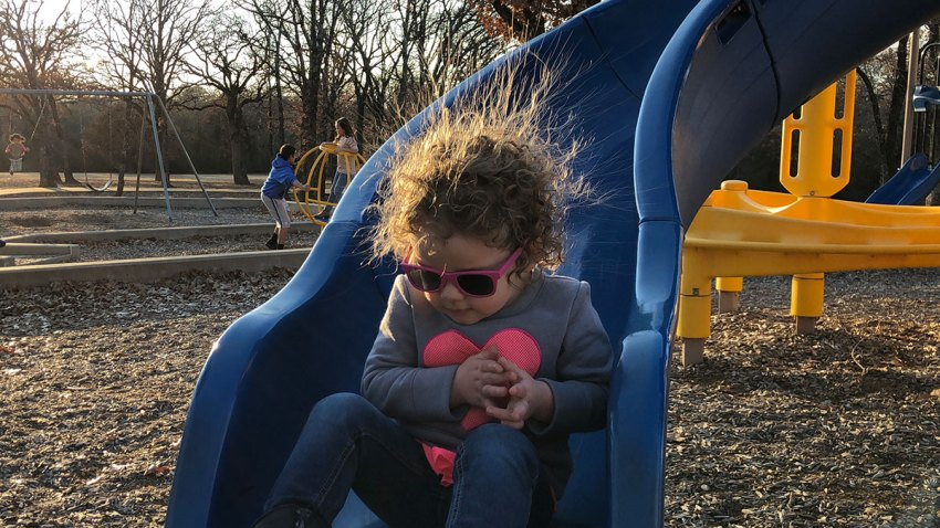 static-electricity-child-girl-slide-park