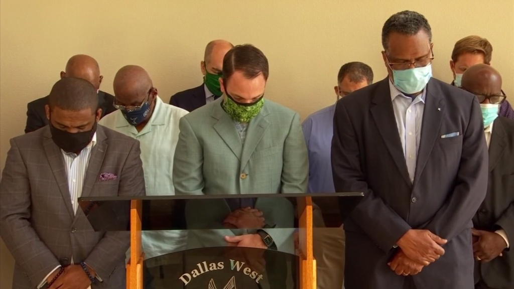 The group of about 15 pastors gathered at Botham Jean's church. He was a young black man murdered by a Dallas police officer. The pastors said they too want justice for George Floyd.