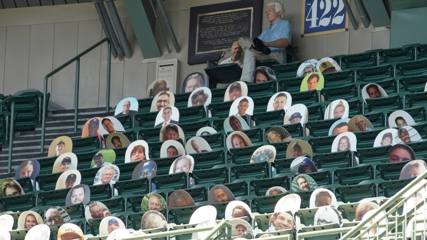 Milwaukee Brewers' fans are seen on picture cut outs in the upper deck during a practice session Monday, July 13, 2020, at Miller Park in Milwaukee.