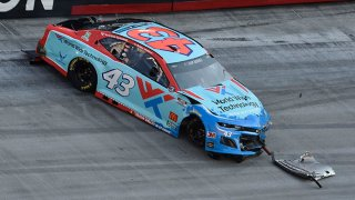Bubba Wallace, driver of the #43 World Wide Technology Chevrolet, spins during the NASCAR Cup Series All-Star Open at Bristol Motor Speedway on July 15, 2020 in Bristol, Tennessee.