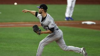 Daniel Bard #52 of the Colorado Rockies throws against the Texas Rangers in the fifth inning at Globe Life Field on July 25, 2020 in Arlington, Texas. The 2020 season had been postponed since March due to the COVID-19 pandemic.