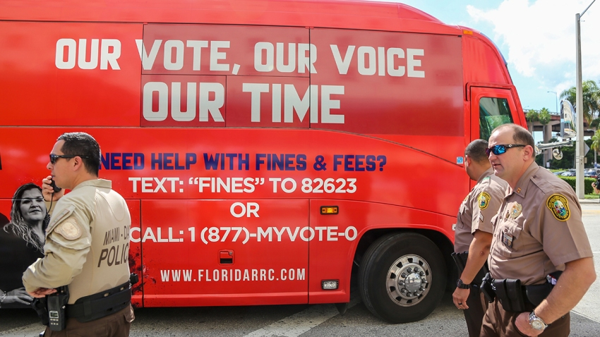 A tour bus sponsored by the Florida Rights Restoration Coalition pulls up to a Miami-Dade County courthouse ahead of a hearing aimed at restoring the right to vote under Florida's Amendment 4 in a Miami-Dade County courtroom, Nov. 8, 2019, in Miami, Fla.