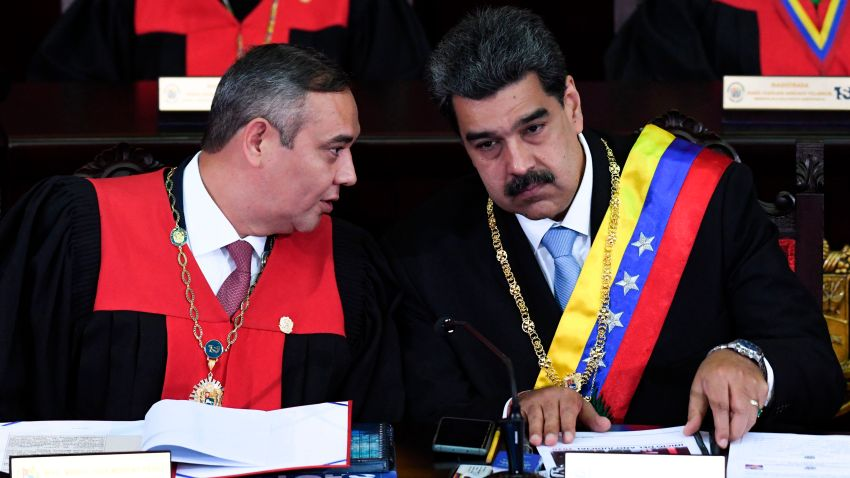 Venezuelan President Nicolas Maduro (R) listens to the president of the Supreme Court of Justice Maikel Moreno (L), during the opening ceremony of the judicial year at the Supreme Court of Justice in Caracas, on Jan. 31, 2020.