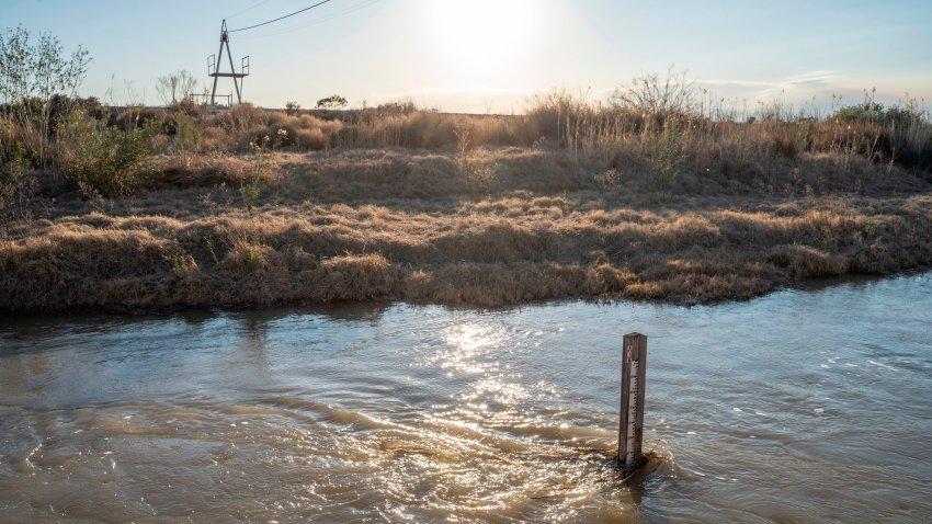 A depth gauge is seen in the Rio Grande