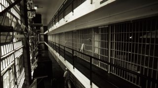 Prison cells line a hall at the Ellis death row unit in Huntsville Prison in Huntsville, Texas.
