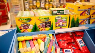 In this file photo, Crayola LLC crayons and other school supplies sit for sale in the back to school section inside a Target Corp. store in Torrance, California, U.S., on Tuesday, August 20, 2013.