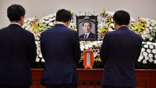 """In this photo provided by Seoul Metropolitan Government, a portrait of the deceased Seoul Mayor Park Won-soon is placed at a hospital in Seoul, South Korea, Friday, July 10, 2020. Park left a note saying he felt """"sorry to all people"""" before he was found dead early Friday, officials in the South Korean capital said as people began mourning the liberal legal activist seen as a potential presidential candidate."""
