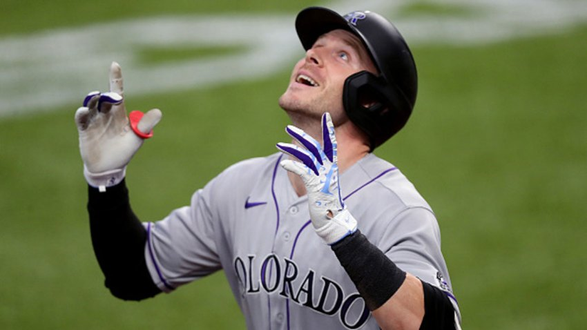 Trevor Story (27) of the Colorado Rockies celebrates after hitting a two-run home run in the top of the fourth inning against the Texas Rangers at Globe Life Field on July 26, 2020 in Arlington, Texas.