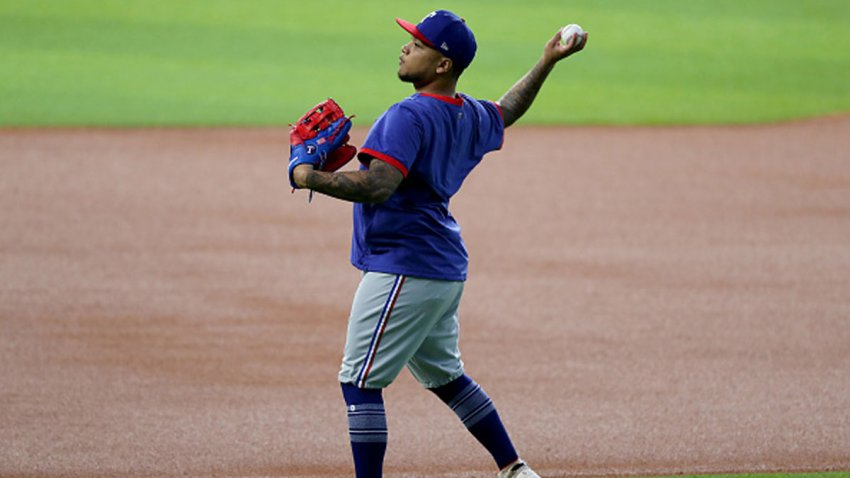 Willie Calhoun #5 of the Texas Rangers warms up during Major League Baseball Summer Workouts at Globe Life Field on July 3, 2020 in Arlington, Texas.