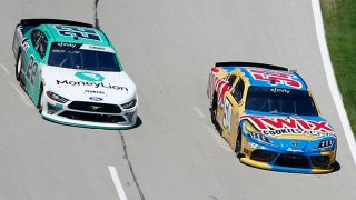 Kyle Busch, driver of the #54 Twix Cookies & Creme Toyota, races Austin Cindric, driver of the #22 MoneyLion Ford, during the NASCAR Xfinity Series Bariatric Solutions 300 at Texas Motor Speedway on July 18, 2020 in Fort Worth, Texas.
