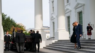 President Donald Trump, first lady Melania Trump, and members of the Trump family watch as the casket of Robert Trump leaves the White House after a memorial service, Friday, Aug. 21, 2020, in Washington.