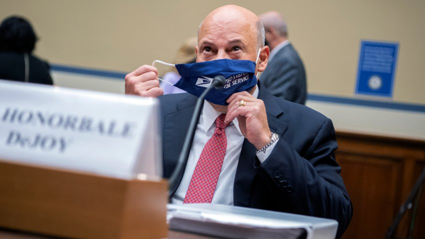 Postmaster General Louis DeJoy removes his face mask as he arrives to testify before a House Oversight and Reform Committee hearing on the Postal Service on Capitol Hill, Monday, Aug. 24, 2020, in Washington.