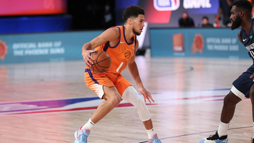 Devin Booker #1 of the Phoenix Suns handles the ball during the game against the Dallas Mavericks on August 2, 2020 at The Visa Athletic Center at ESPN Wide World Of Sports Complex in Reunion, Florida.