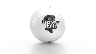 """Ezekiel Elliott and OnCore Golf are teaming up to sell a limited edition """"Everyone Eats"""" logo golf ball for charity."""