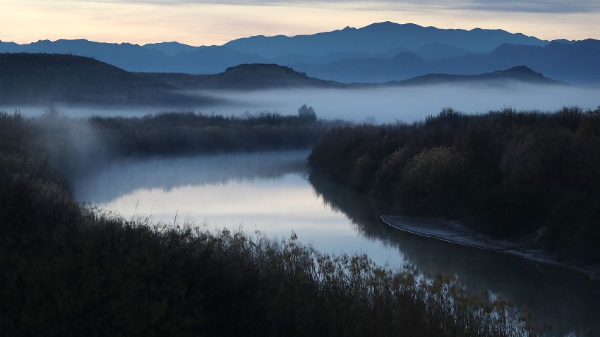 Fog blankets the valley over the Rio Grande river that marks the boundary between the United States (to the left of the river ) and Mexico (to the right of the river) on January 17, 2019 in Presidio, Texas. The U.S. government is partially shutdown as President Donald Trump is asking for $5.7 billion to build additional walls along the U.S.-Mexico border and the Democrats oppose the idea.