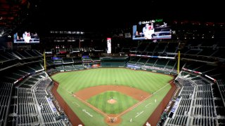 In this Aug. 10, 2020, file photo, Globe Life Field opens its roof before the MLB game between the Seattle Mariners and Texas Rangers at Globe Life Field in Arlington, Texas.