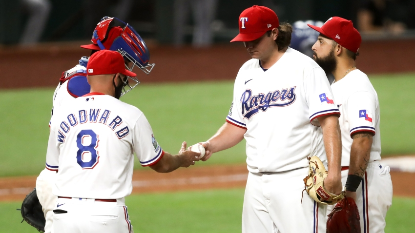 Texas Rangers relieve pitcher Ian Gibaut is taken out during the MLB game between the Seattle Mariners and Texas Rangers on August 10, 2020 at Globe Life Field in Arlington, TX.