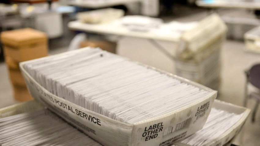 Stacks of mail-in ballots.