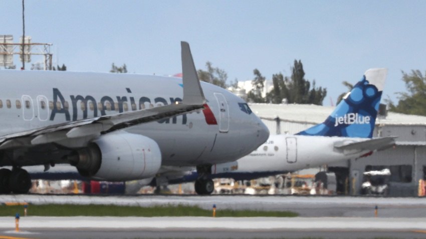 FORT LAUDERDALE, FLORIDA - JULY 16: An American Airlines plane takes off near a parked JetBlue plane at the Fort Lauderdale-Hollywood International Airport on July 16, 2020 in Fort Lauderdale, Florida. JetBlue Airways and American Airlines Group announced they will be creating an alliance between the two companies.