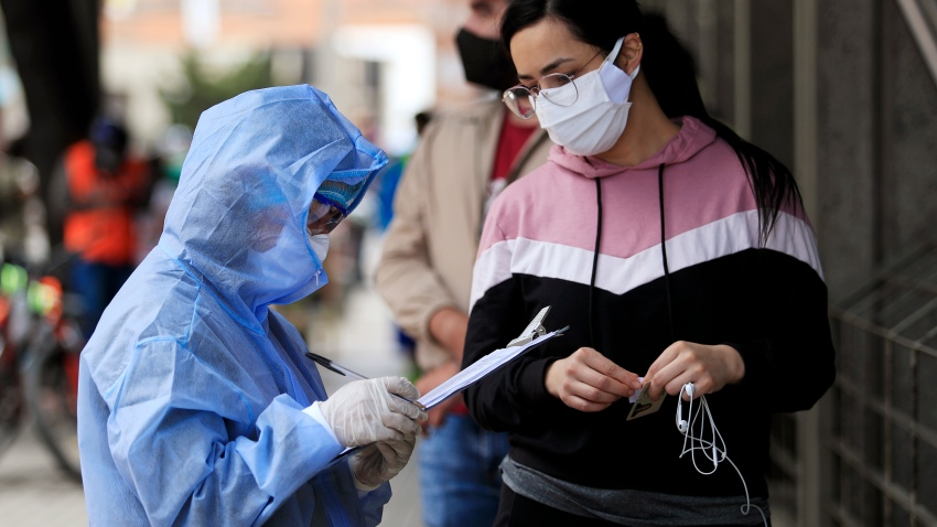 A nurse takes personal information from a woman before a COVID-19 test on July 19, 2020 in Bogota, Colombia. According to World Health Organization, Colombia has registered over 190,700 positive cases of Coronavirus (COVID-19) and more than 6,500 deaths.