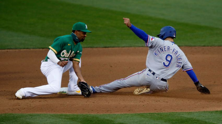 Isiah Kiner-Falefa #9 of the Texas Rangers steals second base ahead of the tag by Marcus Semien #10 of the Oakland Athletics in the top of the fourth inning at Oakland-Alameda County Coliseum on August 05, 2020 in Oakland, California.