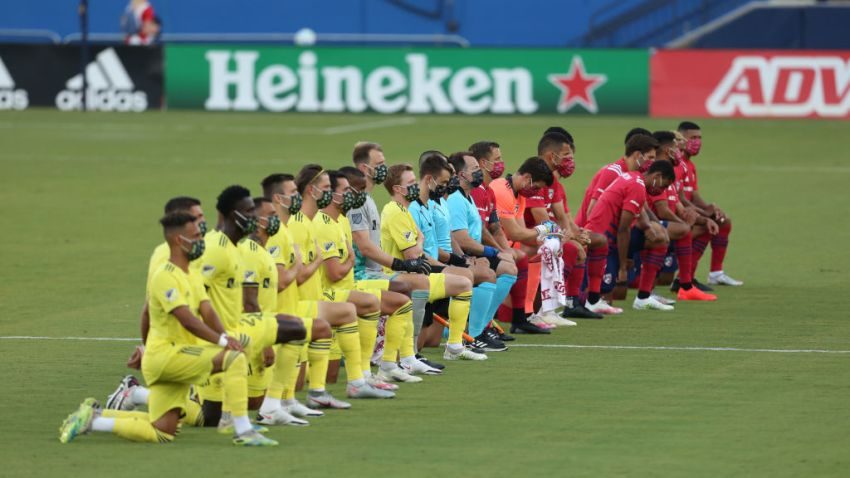 FC Dallas Team (R) and Nashville SC Team get to their knees during the national anthem prior the game game between FC Dallas and Nashville SC as part of the Major League Soccer 2020 at Toyota Stadium on August 12, 2020 in Frisco, Texas.
