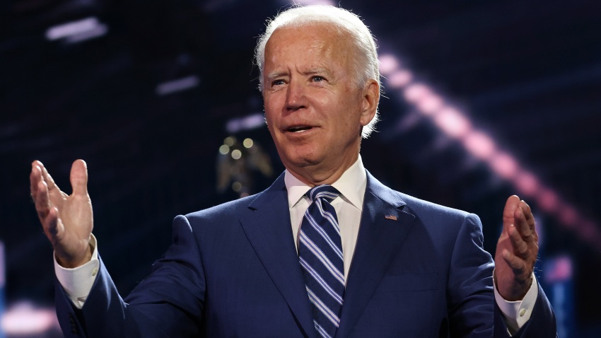In this Aug .19, 2020, file photo, Democratic presidential nominee Joe Biden appears on stage after Democratic vice presidential nominee U.S. Sen. Kamala Harris (D-CA) spoke on the third night of the Democratic National Convention from the Chase Center in Wilmington, Delaware.