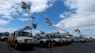 Electric utility trucks are staged along Lake Pontchartrain as in preparation for Tropical Storms Marco and Laura on August 24, 2020 in Kenner, Louisiana.