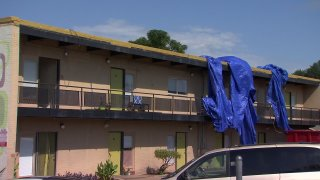 Hurst Fire Chief David Palla said the tarp had been covering an ongoing roof repair and it had been blown over to one side letting rain into the upstairs apartments and lower units.
