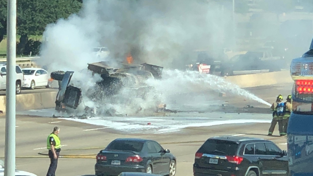 A vehicle flipped over and caught fire in the northbound lanes of US 75 in Richardson Wednesday morning.