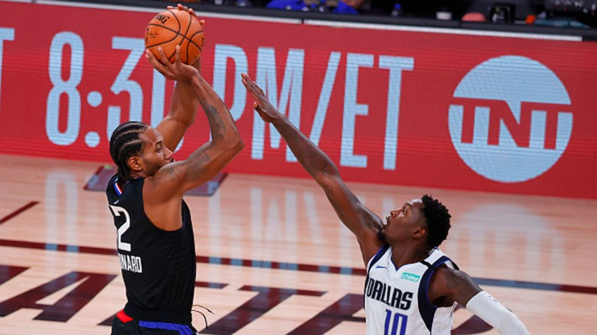 Kawhi Leonard #2 of the LA Clippers shoots against Dorian Finney-Smith #10 of the Dallas Mavericks during the second quarter in Game Six of the Western Conference First Round during the 2020 NBA Playoffs at AdventHealth Arena at ESPN Wide World Of Sports Complex on Aug. 30, 2020 in Lake Buena Vista, Florida.