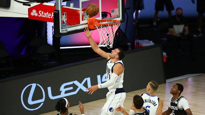 Luka Doncic #77 of the Dallas Mavericks shoots against the Sacramento Kings in the second half of a NBA basketball game at HP Field House at ESPN Wide World Of Sports Complex on Aug. 4, 2020 in Lake Buena Vista, Florida.