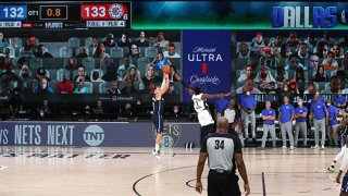 Luka Doncic #77 of the Dallas Mavericks hits the game-winning three-pointer in overtime against the LA Clippers during Round One, Game Four of the NBA Playoffs on Aug. 23, 2020 at the AdventHealth Arena at ESPN Wide World Of Sports Complex in Orlando, Florida.