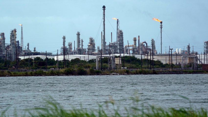 A refinery is seen along the water, Wednesday, Aug. 26, 2020, in Port Arthur, Texas. The energy industry is bracing for catastrophic storm surges and winds as Hurricane Laura cuts a dangerous path toward the coastlines of Texas and Louisiana.