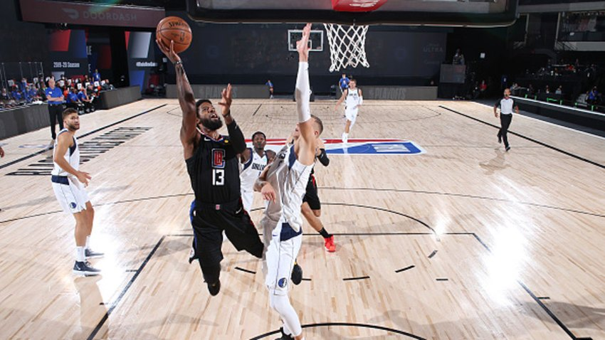 Paul George #13 of the LA Clippers shoots the ball against the Dallas Mavericks during Round One, Game One of the NBA Playoffs on Aug. 17, 2020 at AdventHealth Arena in Orlando, Florida.