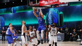 Kristaps Porzingis #6 of the Dallas Mavericks shoots the ball against the LA Clippers during Round One, Game One of the NBA Playoffs on Aug. 21, 2020 in Orlando, Florida at AdventHealth Arena.
