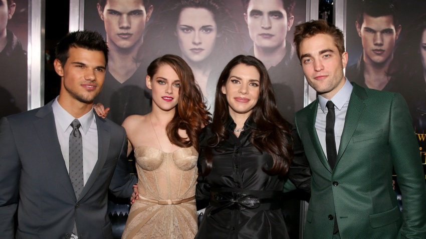 """In this Nov. 12, 2012, file photo, actors Taylor Lautner, Kristen Stewart, author Stephenie Meyer, and actor Robert Pattinson arrive at the premiere of Summit Entertainment's """"The Twilight Saga: Breaking Dawn - Part 2"""" at Nokia Theatre L.A. Live in Los Angeles, California."""