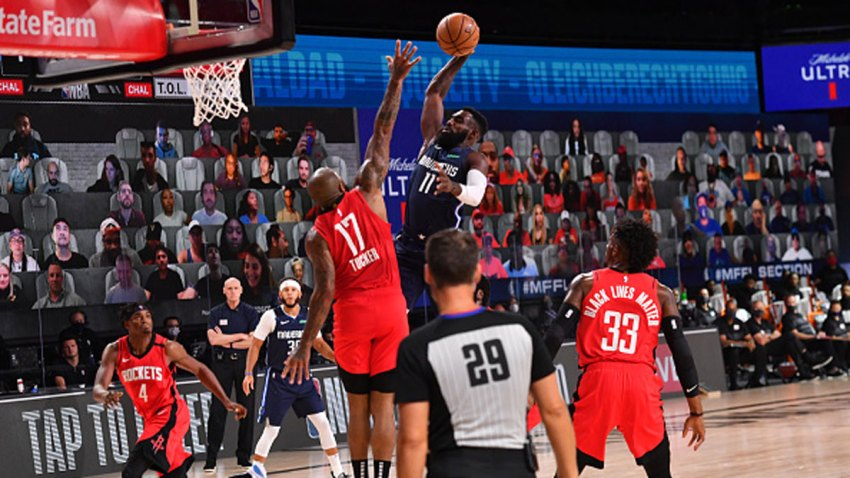 Tim Hardaway Jr. #11 of the Dallas Mavericks dunks the ball against the Houston Rockets on July 31, 2020 at The Arena at ESPN Wide World Of Sports Complex in Orlando, Florida.