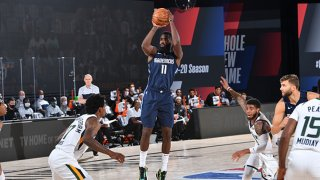 Tim Hardaway Jr. #11 of the Dallas Mavericks shoots the ball against the Utah Jazz on August 10, 2020 at Visa Athletic Center at the AdventHealth Arena at in Orlando, Florida.