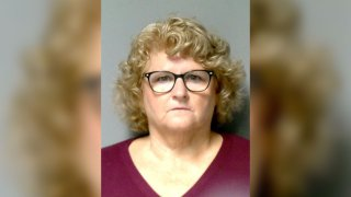 In this handout photo provided by Lansing Police Department, Ex-Michigan State University women's gymnastics coach Kathie Klages poses for a mug shot photo on August 30, 2018 in Lansing, Michigan.