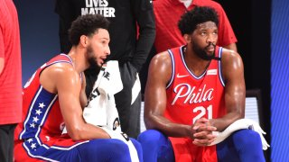 Ben Simmons #25 of the Philadelphia 76ers and Joel Embiid #21 of the Philadelphia 76ers look on during a game against the Washington Wizards