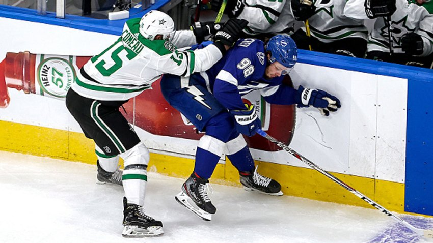 Mikhail Sergachev #98 of the Tampa Bay Lightning is checked by Blake Comeau #15 of the Dallas Stars during the first period in Game Two of the 2020 NHL Stanley Cup Final at Rogers Place on Sept. 21, 2020 in Edmonton, Alberta, Canada.