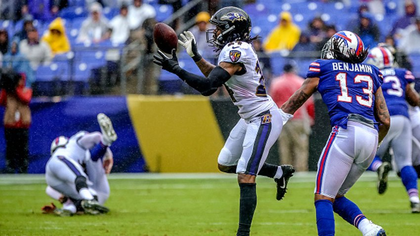 Baltimore Ravens defensive back Brandon Carr (24) intercepts the football thrown by Buffalo Bills quarterback Nathan Peterman (2) during the game between the Buffalo Bills and the Baltimore Ravens on Sept. 9, 2018, at M&T Bank Stadium in Baltimore, MD. The Ravens defeated the Bills, 47-3.