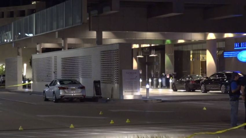 Officers responded about 2:47 a.m. to the shooting call in the 13340 block of Dallas Parkway, where witnesses told police a group of males in a dark-colored sedan shot at a white Mercedes in front of the hotel.
