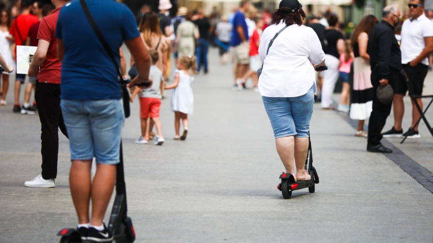 Tourists ride on electric scooters at the Main Square, popular tourist destination, during the coronavirus pandemic.