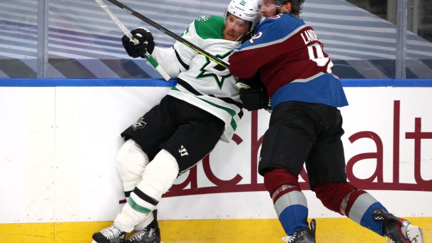 Gabriel Landeskog #92 of the Colorado Avalanche checks Joe Pavelski #16 of the Dallas Stars during the first period of Game Five of the Western Conference Second Round during the 2020 NHL Stanley Cup Playoffs at Rogers Place on August 31, 2020 in Edmonton, Alberta.