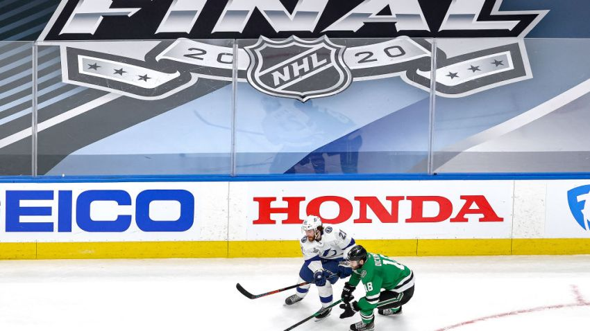 Brayden Point #21 of the Tampa Bay Lightning battles for the puck with Jason Dickinson #18 of the Dallas Stars during the second period in Game Three of the 2020 NHL Stanley Cup Final at Rogers Place on September 23, 2020 in Edmonton, Alberta, Canada.